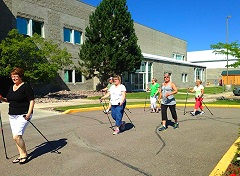Participants in the Kalispell (Montana) Diabetes Prevention Program practice Nordic walking during one of the program's sessions