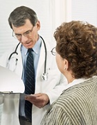 Male doctor looking at patient chart