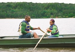 man and daughter in boat