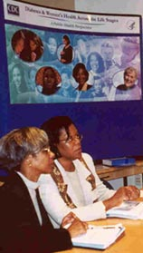 A photo of Gloria Beckles, left, and Patricia Thompson-Reid, co-editors of Diabetes and Women's Health Across the Life Stages: A Public Health Perspective, preparing for a women's task force meeting.