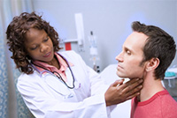 Doctor examining adult male patient