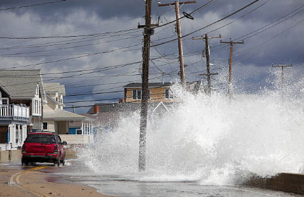 A car driving through storm surge and flooding