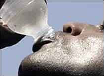 Photo of athlete drinking water.