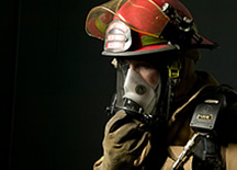 Firefighter with a breathing mask.