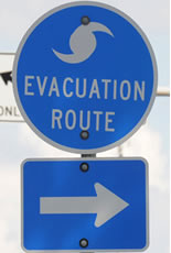 Hurricane evacuation sign with arrow pointing to the right.