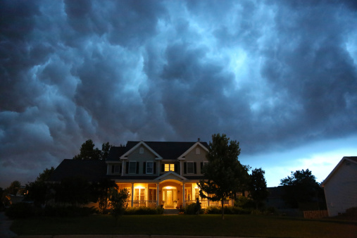 A house with storm clouds floating above