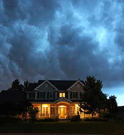 Photo of cloudy sky over a house