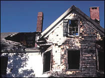 Photo of burnt house.
