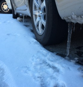 Car on Road with Icicles Forming on Bumper