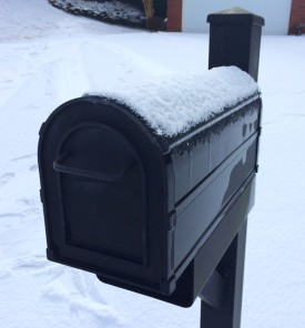 Curbside Mailbox with Melting Snow on Its Top