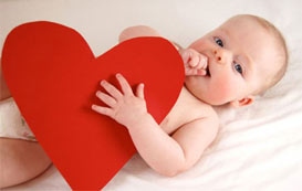 Baby with paper heart