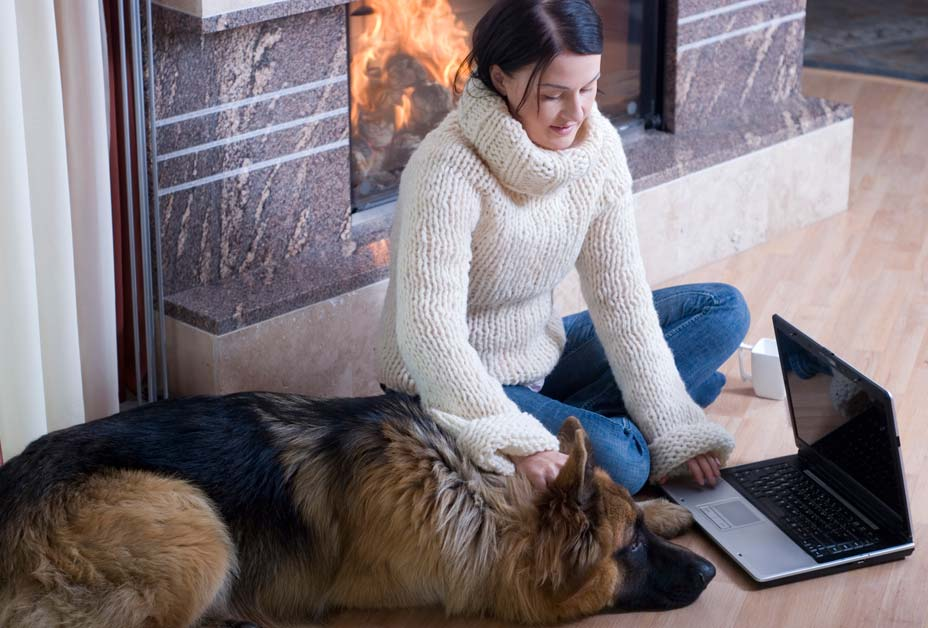 Woman on floor with dog and laptop