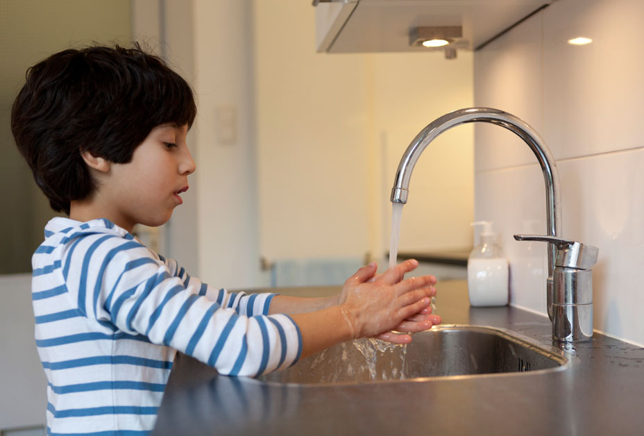Boy washing hands