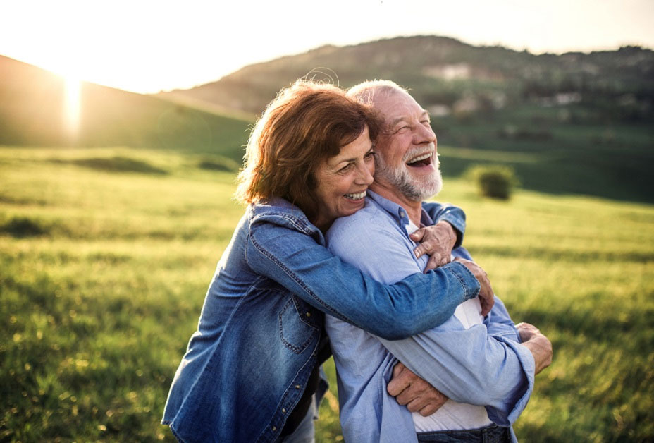 Man and woman blowing bubbles