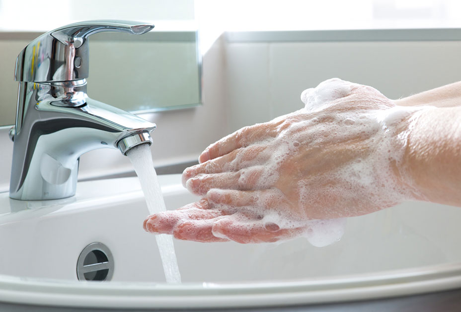 Soapy hands and faucet
