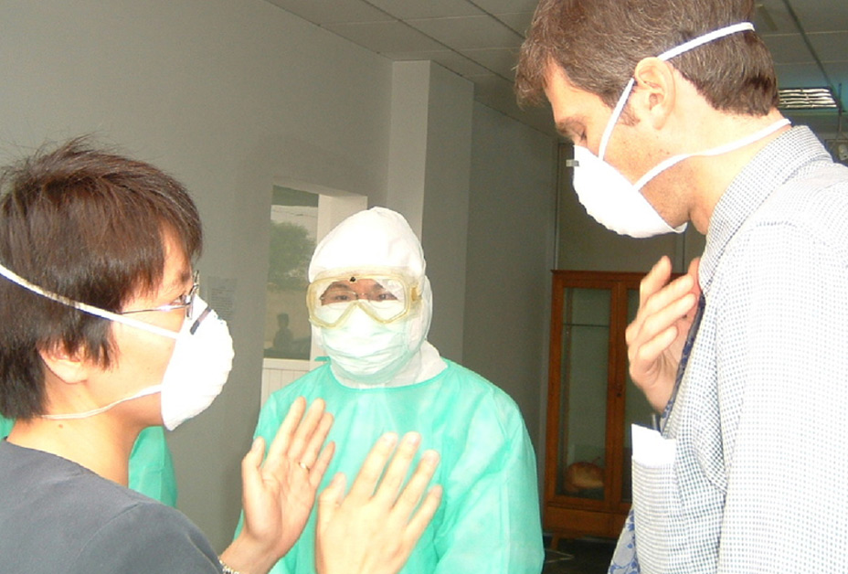 Doctors wearing masks consulting
