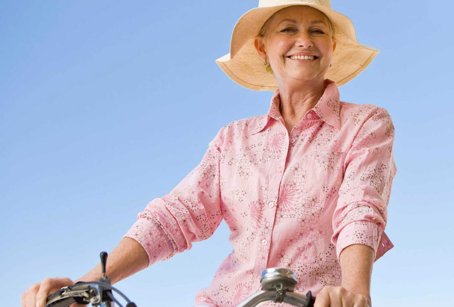 Woman riding bicycle with long sleeves on