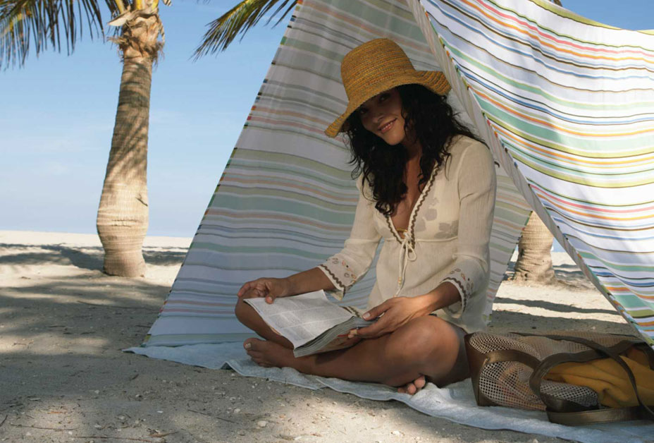 Woman reading book in the shade