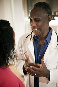 Photo: doctor speaking with patient