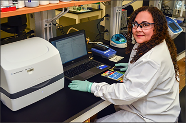 Brunie Burgos White, PhD, an LLS Fellow with CDC's Division of STD Prevention, conducts laboratory work.