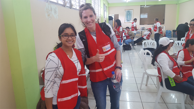 Amy Lavery, PhD, MSPH, EIS Class of 2017 (right) and Anindita Issa, MD, EIS Class of 2016, prepare to work in the field with a team of interviewers assisting with a CAPSER (community assessment for public health emergency response) in Puerto Rico a few months after hurricanes Irma and Maria.