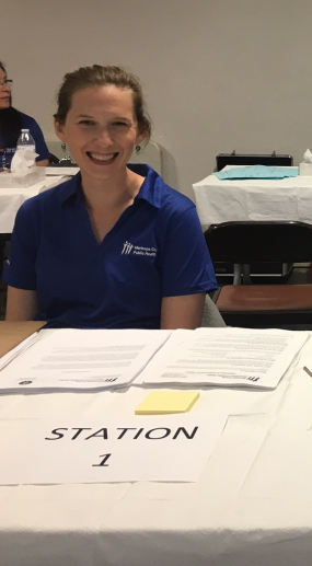 Sally Ann Iverson, DVM, MPH, EIS Class of 2016, prepares to interview vaccination clinic participants during a 2017 outbreak of Hepatitis A among people experiencing homelessness in Maricopa County, Arizona.