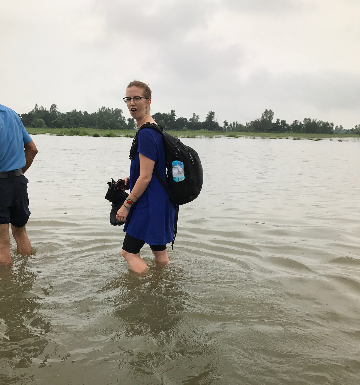 Blanche Greene-Cramer, DrPH, MPH, EIS Class of 2016, wades through flood waters. Photo Credit: Endang Handzel