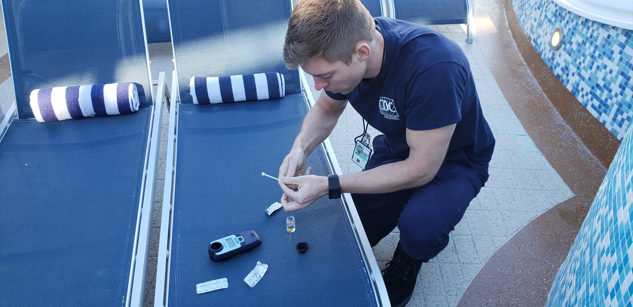 EIS Officer Jared Rispens, MD, tests the pH and chlorine content of water