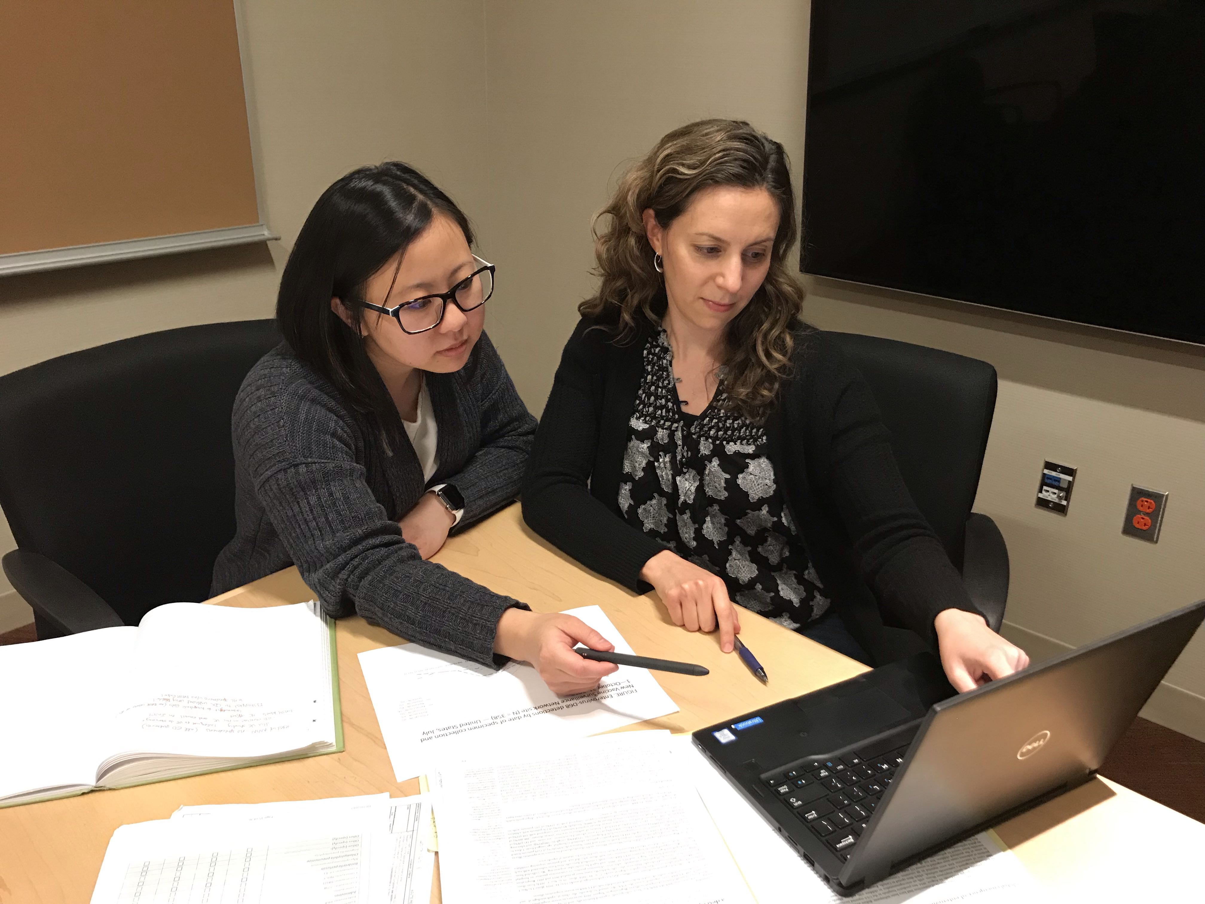 colleagues reviewing data