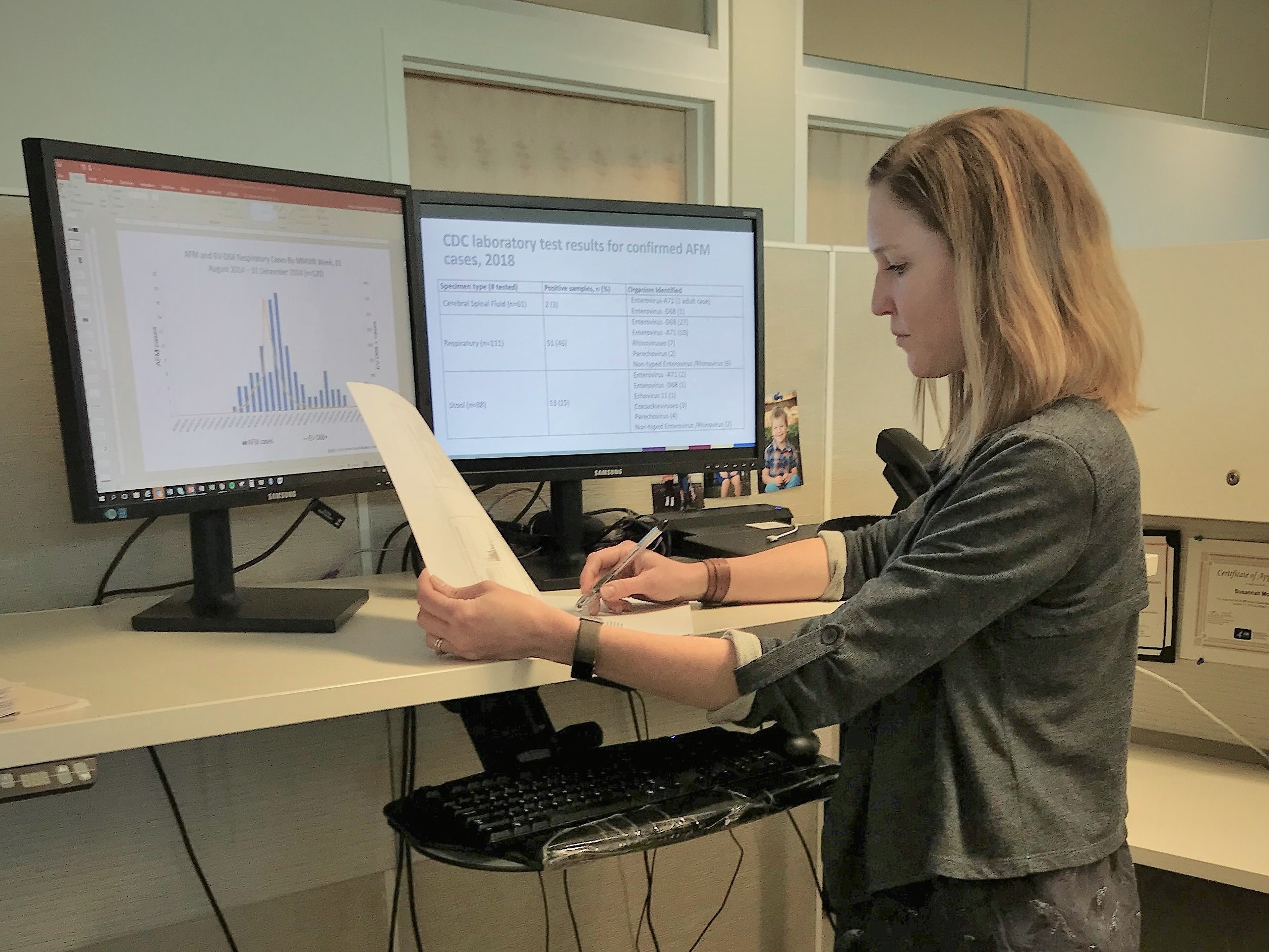 EIS officer Susannah McKay, PhD, MPH, works at her desk