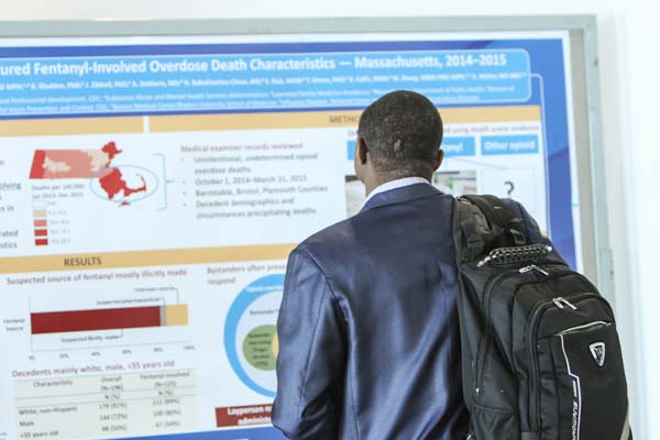 Conference attendee studies poster presentation