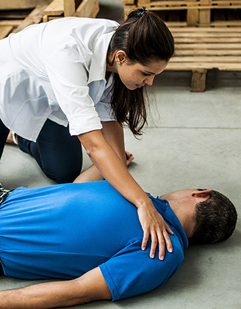 Woman attending to collapsed man