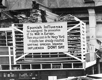 """Photograph of an Influenza precaution sign at the Naval Aircraft Factory, Philadelphia, October 19, 1918. Reads """"Spanish Influenza has endangered the prosecution of the war in Europe. There are 1500 cases in the navy yard 30. Deaths have already resulted. Spitting spreads Spanish influenza. Don't spit."""