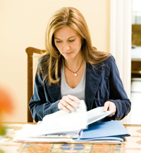 Photo: Woman looking through documents
