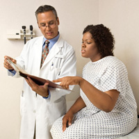 Photo: Patient reviewing records with doctor