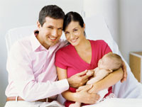 Photo: Couple with young baby