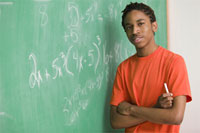 Photo: Student at chalkboard