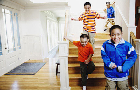 American Indian/Alaska Native (AI/AN) children hurrying down the stairs