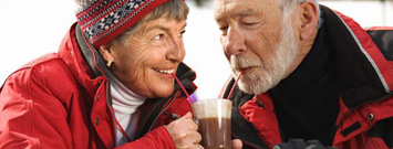 Photo: A senior couple drinking hot chocolate