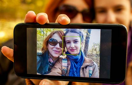 Mother and daughter taking selfie with smartphone