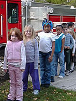 Photo: Children by a Fire Truck.