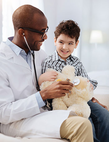Image of doctor with young patient.