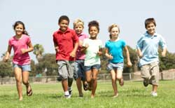 Group of young children running