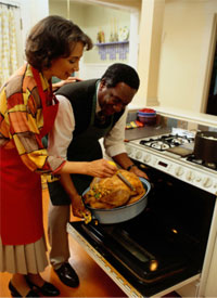 Photo: Checking the temperature of a roasted turkey.