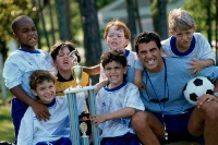 Photo: Children with soccer coach