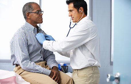 Doctor talking with mature man