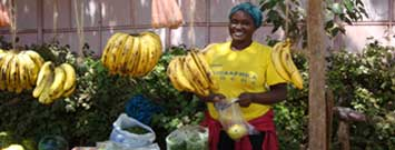 Photo: Woman selling fruits and vegetables