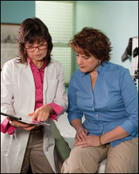 Photo: A healthcare professional talking with a patient.