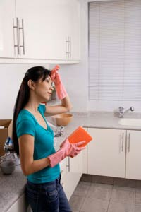 Photo: A woman cleaning.