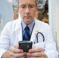 Photo: A healthcare professional texting.